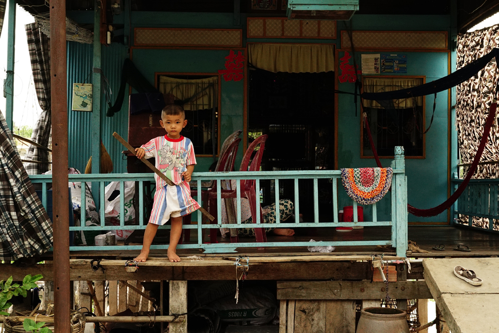 14.Warrior Kid on the porch of his stilt house