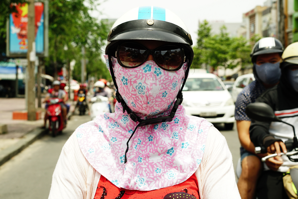Girl with a pink flowery %22Cover-up Style%22 driving on the streets of H.C.M.C., Girl with a pink flowery %22Cover-up Style%22 driving on the streets of H.C.M.C., Vietnam, June 2015