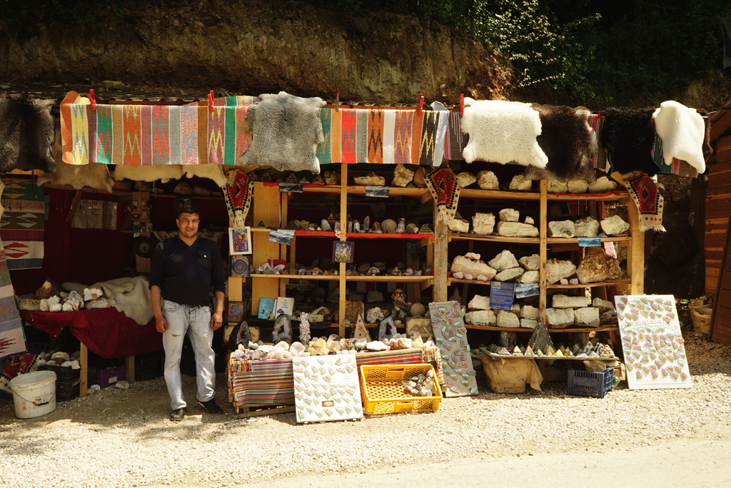 Vendor outside the Tunnel Ravne, May, 2017.
