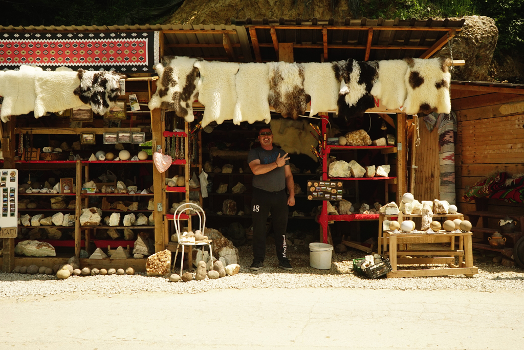 Souvenirs vendor outside the Tunnel Ravne, May, 2017.